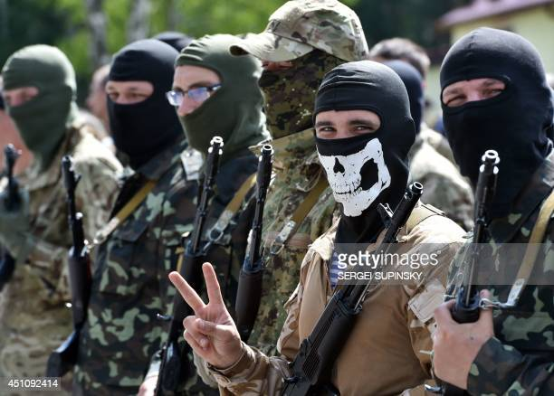 A new volunteer recruit of the Ukrainian army 'Donbass' battalion flashes a 'victory sign' during a military oath ceremony of the National Guard near...