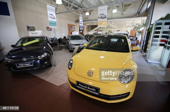 New VW Beetle right and Polo vehicles stand in an automobile showroom operated by Volkswagen AG in Moscow Russia on Friday March 28 2014 Foreign...