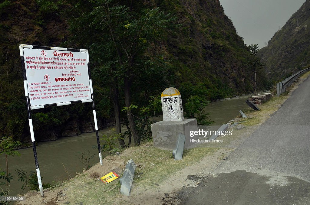 new warning boards which were set up on bank of Beas river after Beas river tragedy on June 11, 2014 in Mandi, India. The rescue team had recovered six bodies so far from the river. A wall of water washed away 24 engineering students and a tour operator Sunday evening after water was released into the river allegedly without a warning from a nearby Pandoh Dam on Beas River.