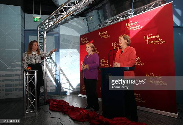 A new wax figure of German Chancellor Angela Merkel is presented at Madame Tussauds wax museum next to an earlier one from 2005 on September 19 2013...