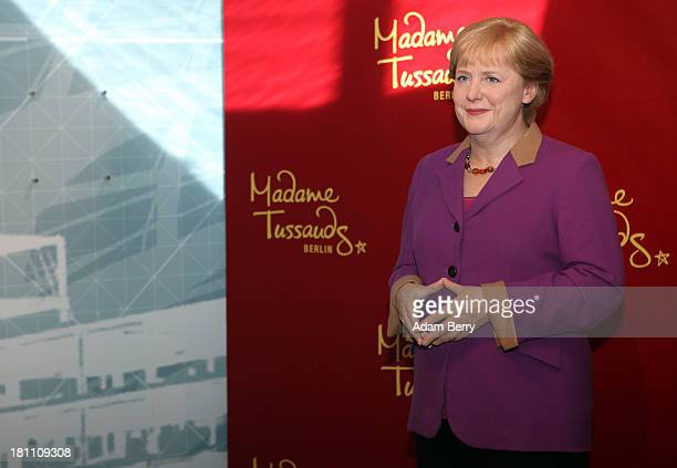 A new wax figure of German Chancellor Angela Merkel stands at Madame Tussauds wax museum on September 19 2013 in Berlin Germany Merkel is the first...