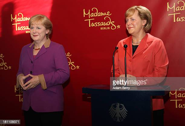 A new wax figure of German Chancellor Angela Merkel stands next to an earlier one from 2005 at Madame Tussauds wax museum on September 19 2013 in...