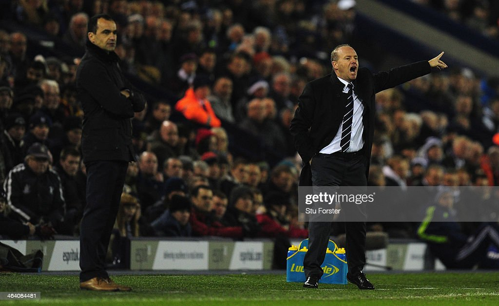 New West Brom manager <a gi-track='captionPersonalityLinkClicked' href=/galleries/search?phrase=Pepe+Mel&family=editorial&specificpeople=3667674 ng-click='$event.stopPropagation()'>Pepe Mel</a> (r) reacts alongside Everton manager Roberto Martinez during the Barclays premier league match between West Bromwich Albion and Everton at The Hawthorns on January 20, 2014 in West Bromwich, England.