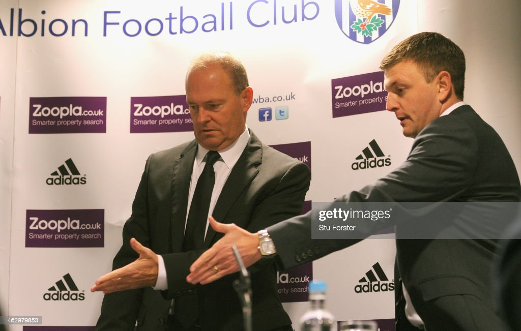 New West Bromwich Albion manager <a gi-track='captionPersonalityLinkClicked' href=/galleries/search?phrase=Pepe+Mel&family=editorial&specificpeople=3667674 ng-click='$event.stopPropagation()'>Pepe Mel</a> is shown to his seat at the table by Richard Garlick, sporting and technical director, before facing the media at the press conference to announce his arrival, at The Hawthorns on January 16, 2014 in West Bromwich, England.