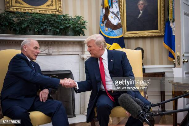 New White House Chief of Staff John Kelly and President Donald Trump shake hands after being privately sworn in during a ceremony in the Oval Office...