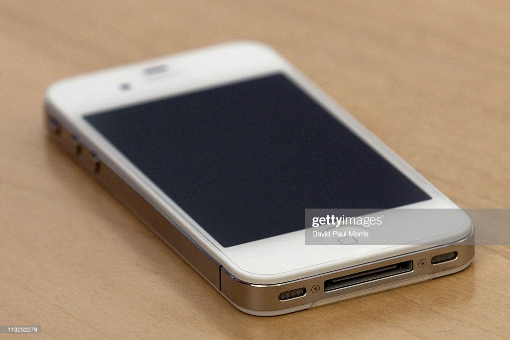 A new white iPhone 4 is displayed on the counter as a customer waits to activate service at the Apple store April 28, 2011 in Palo Alto, California. The long awaited white iPhone, first announced in June of 2010, went on sale worldwide for the first time today.