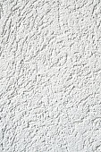 New white relief plaster on wall closeup
