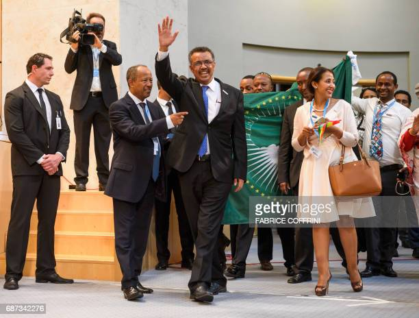 New WHO Director General Ethiopia's Tedros Adhanom Ghebreyesus waves as he enters the room after his election during the World Health Assembly on May...