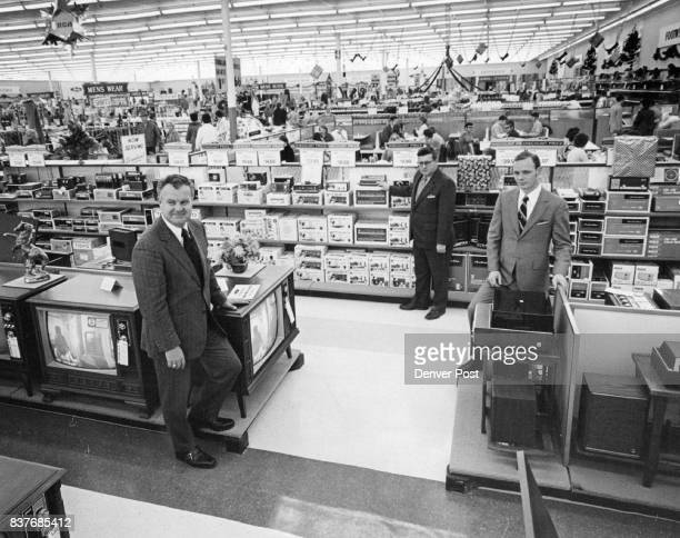New Woolco discount store opens in Southeast Denver Three executives are shown inside the spacious new Woolco Department Store which opened Wednesday...