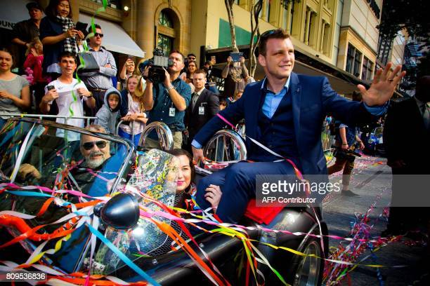 New World Boxing Organization welterweight title holder Jeff Horn and his wife Jo of Australia during his postmatch victory parade at Brisbane's...