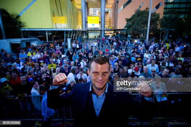 TOPSHOT New World Boxing Organization welterweight title holder Jeff Horn of Australia poses during his postmatch parade at Brisbane's Queen Street...