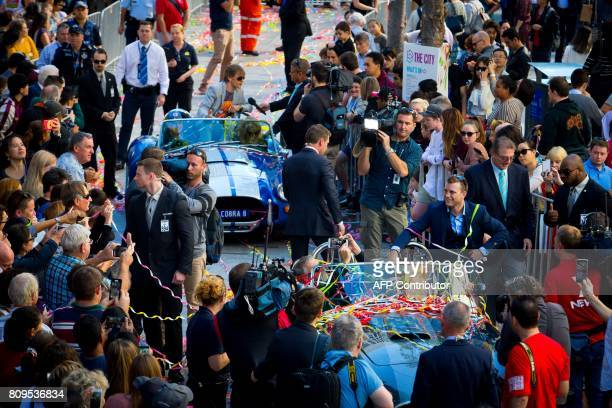 New World Boxing Organization welterweight title holder Jeff Horn gestures during his postmatch victory parade at Brisbane's Queen Street Mall on...