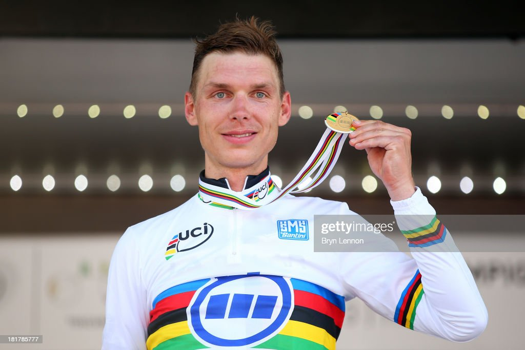 New world champion and gold medal winner <a gi-track='captionPersonalityLinkClicked' href=/galleries/search?phrase=Tony+Martin+-+Cyclist&family=editorial&specificpeople=5399396 ng-click='$event.stopPropagation()'>Tony Martin</a> of Germany celebrates on the podium after winning the Elite Men's Time Trial, from Montecatini Terme to Florence on September 25, 2013 in Florence, Italy.