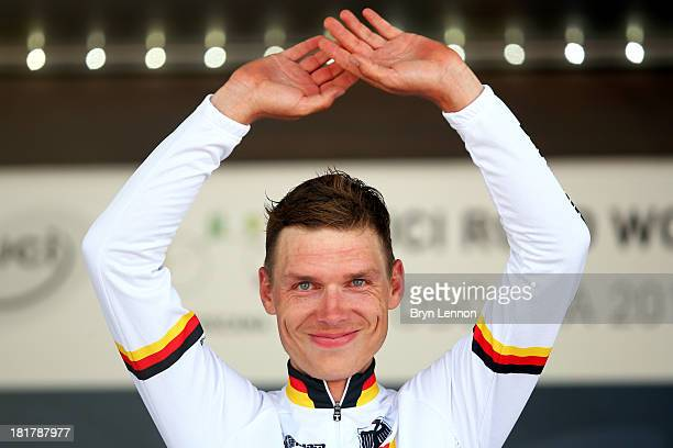 New world champion and gold medal winner Tony Martin of Germany celebrates on the podium after winning the Elite Men's Time Trial from Montecatini...