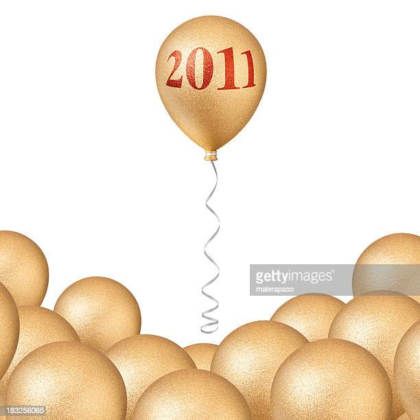 Neues Jahr 2011. Goldene Ballons.