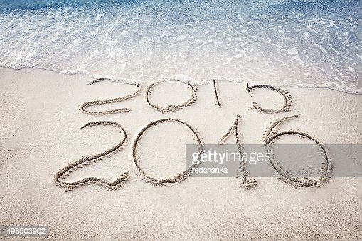 New Year 2016 replace 2015 concept on the sea beach : Stock Photo
