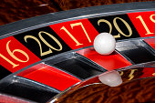 New Year 2017 classic casino roulette wheel with red sector seventeen 17 and white ball and sectors 20, 16, 18