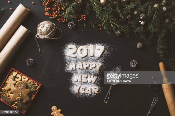 New year 2017, presents and powder sugar cookies on table