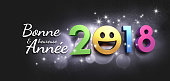 Happy New Year 2018 date with a smiling face and Greetings in French language, on a glittering black background - 3D illustration
