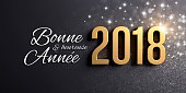 New Year date 2018 colored in gold, on a festive black background, with glitters, stars and Greetings in French - 3D illustration