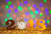 New Year 2018 with Gold Clock on Colored Background