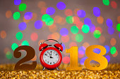 New Year 2018 with Red Clock on Colored Background