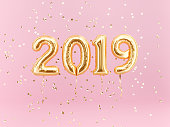 New year 2019 celebration. Gold foil balloons numeral 2019 and confetti on pink background. 3d rendering