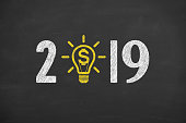 New Year 2019 Finance Concepts on Chalkboard Background