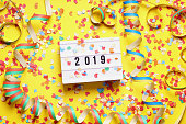 2019 new year celebration flat lay concept with confetti and streamers
