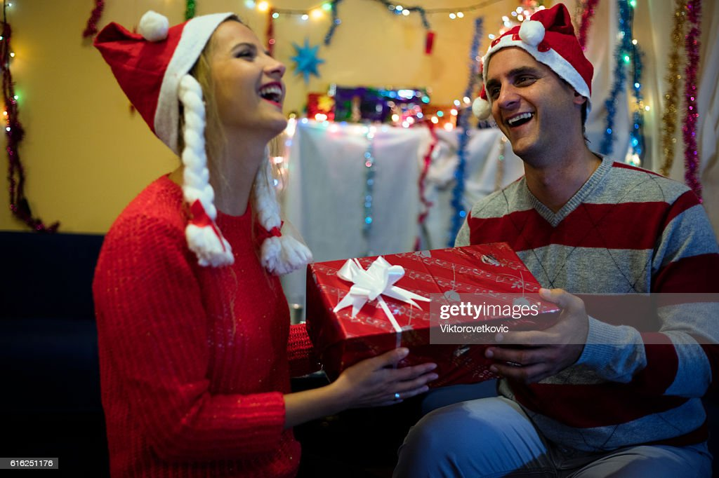 New Year. Christmas portrait of relaxed couple with gifts. : Foto de stock