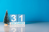 New year. December 31st. Day 31 of december month, calendar with little christmas tree on blue background. Winter time. Empty space for text. New year concept.