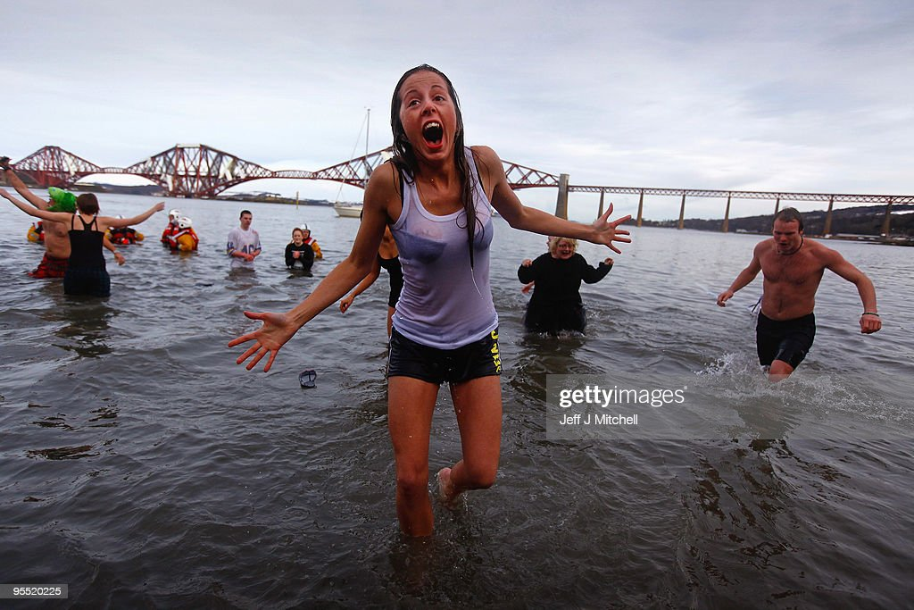 New Year revellers, many in fancy dress, braved freezing conditions at the River Forth in front of the Forth Rail Bridge during the Loony Dook Swim on January 1, 2010 in South Queensferry, Scotland. Many of Scotland�s Hogmanay celebrations were cancelled last night due to the cold weather, but around eighty thousand people still attended the street party in Edinburgh.