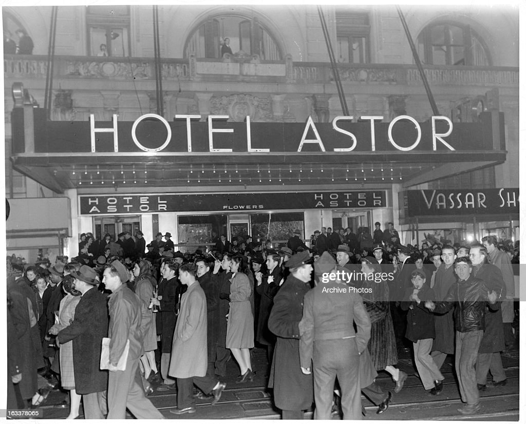 New Year's celebrants walking outside of the Waldorf Astoria on Broadway in New York City 1946