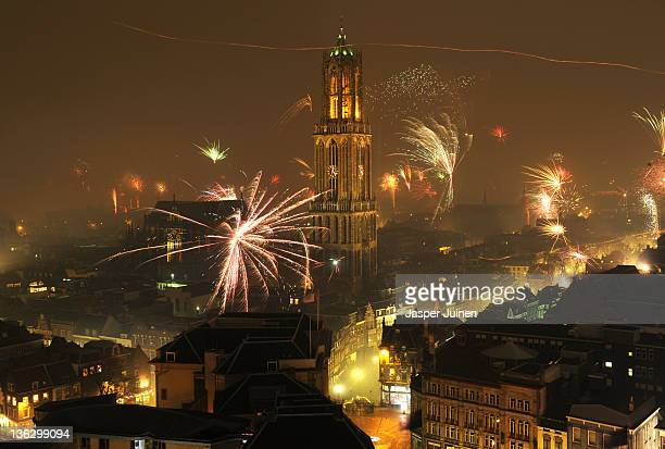 New Year's Eve fireworks display illuminates the sky over the Dom Tower on January 01 2012 in Utrecht Netherlands The Dom tower is with 1125 metres...