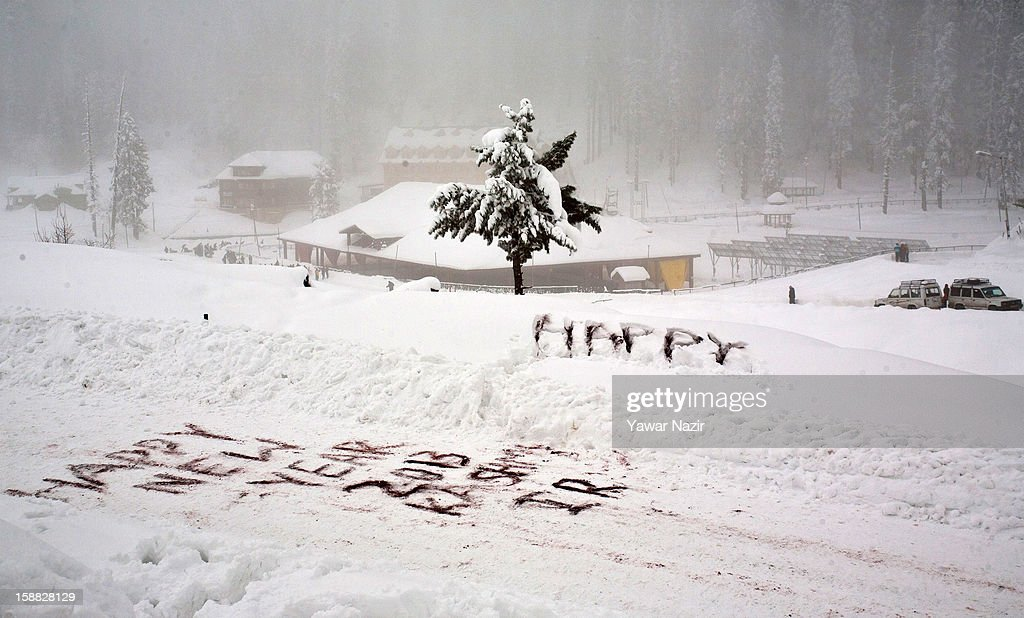 A New Year's greeting written in the snow on December 31, 2012 in Gulmarg, to the west of Srinagar, the summer capital of Indian-administered Kashmir, India. Following the second round of heavy snowfall in Kashmir valley, skiers from around the globe have reached the famous ski resort of Gulmarg, located less than six miles from the ceasefire line - or Line of Control (LoC) - that divides Kashmir from India and Pakistan. The resort is known for long-run skiing, snow-boarding, heli-skiing and steep mountains. A number of foreign governments, including the United Kingdom, have lifted travel advisories to citizens traveling to Kashmir which has raised the hopes of the local tourism industry following violence in the region.