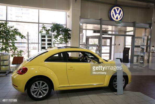 A new yellow VW Beetle vehicle stands on display in an automobile showroom operated by Volkswagen AG in Moscow Russia on Friday March 28 2014 Foreign...