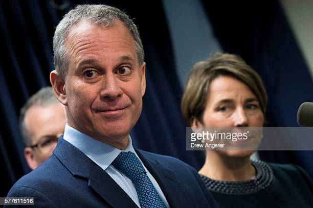 New York Attorney General Eric Schneiderman and Massachusetts Attorney General Maura Healey listen to a question from a reporter during a press...
