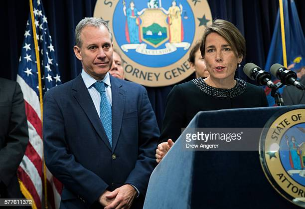 New York Attorney General Eric Schneiderman looks on as Massachusetts Attorney General Maura Healey speaks during a press conference at the office of...