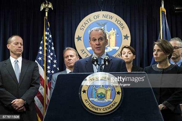 New York Attorney General Eric Schneiderman speaks as Massachusetts Attorney General Maura Healey looks on during a press conference at the office of...