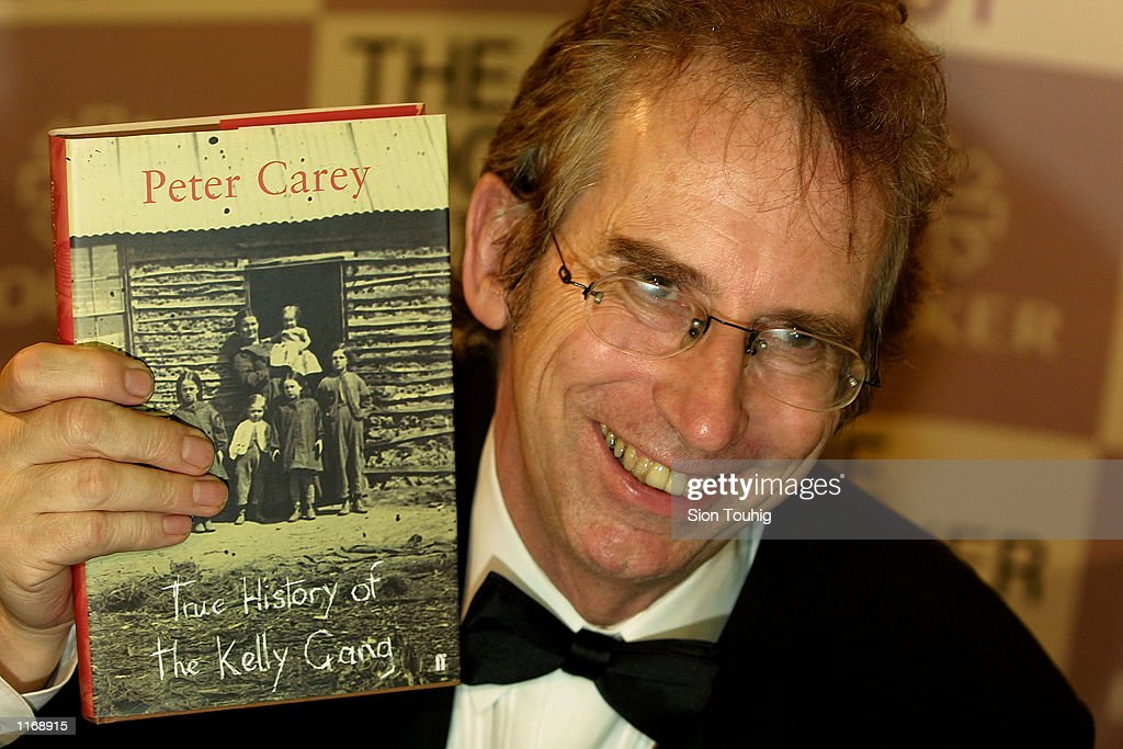 New York based Australian author Peter Carey smiles for the press after he wins the Booker Prize for his book ''True History of the Kelly Gang'' October 17, 2001 at the Guildhall in London.
