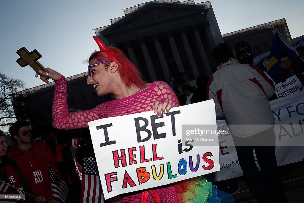 New York based drag performer Qween Amor dances during a rally in front of the U.S. Supreme Court on March 26, 2013 in Washington, DC. Today the Supreme Court is scheduled to hear arguments in California's proposition 8, the controversial ballot initiative that defines marriage as between a man and a woman.