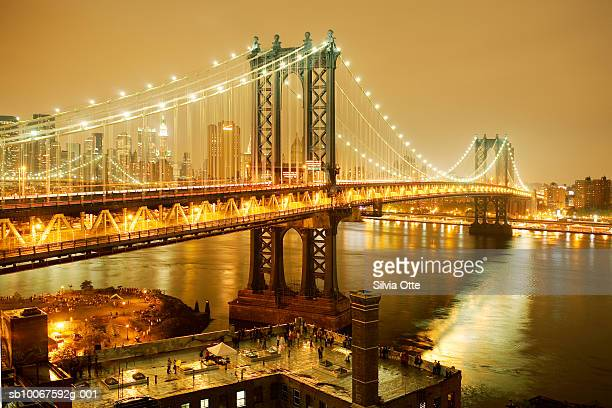 USA, New York, Brooklyn Bridge, Brooklyn and Manhattan at night on 4th of July