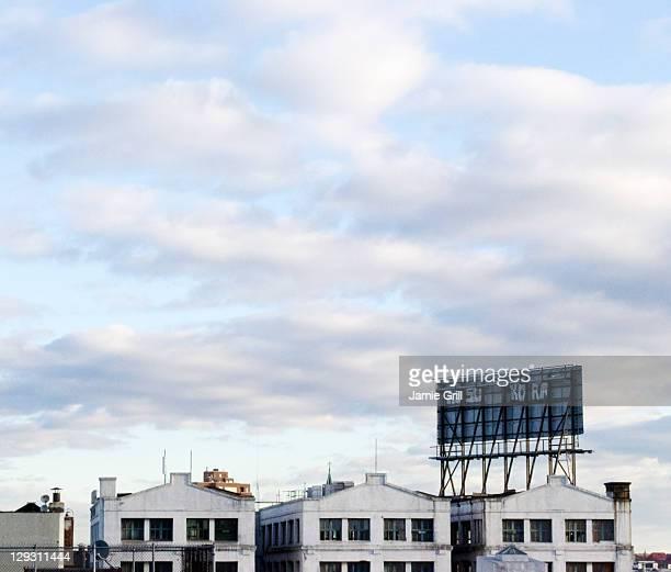 USA, New York, Brooklyn, Williamsburg, Houses against cloudy sky