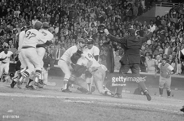 Carl Yastrzemski of the Boston Red Sox and Sandy Alomar of the New York Yankees try to break up fight between Lou Pinella of the Yanks and the Red...