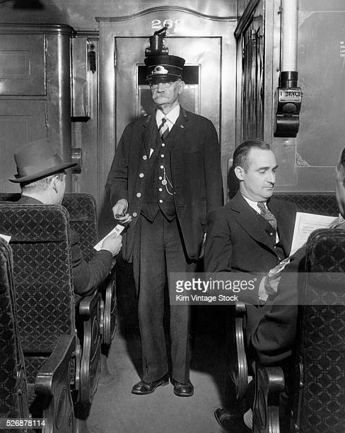 A New York Central ticket taker does his job in a passenger car
