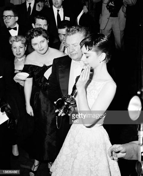 AWARDS New York Ceremony Air Date Pictured Actor Jean Hersholt Best Actress winner Audrey Hepburn for 'Roman Holiday' during the 26th Annual Academy...
