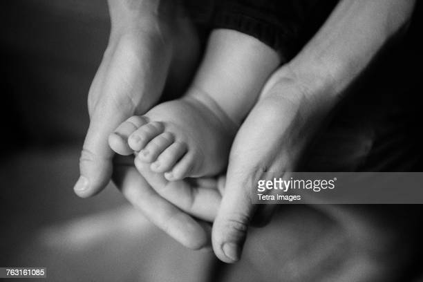 New York City, Brooklyn, Mother holding babys foot (6-11 months)