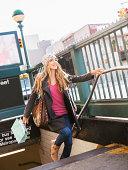 USA, New York City, Brooklyn, Williamsburg, Portrait of blond woman leaving subway station