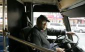 New York City bus driver David Smith sits in his New York City bus December 14 2005 in New York City New York City Transit workers are threatening to...