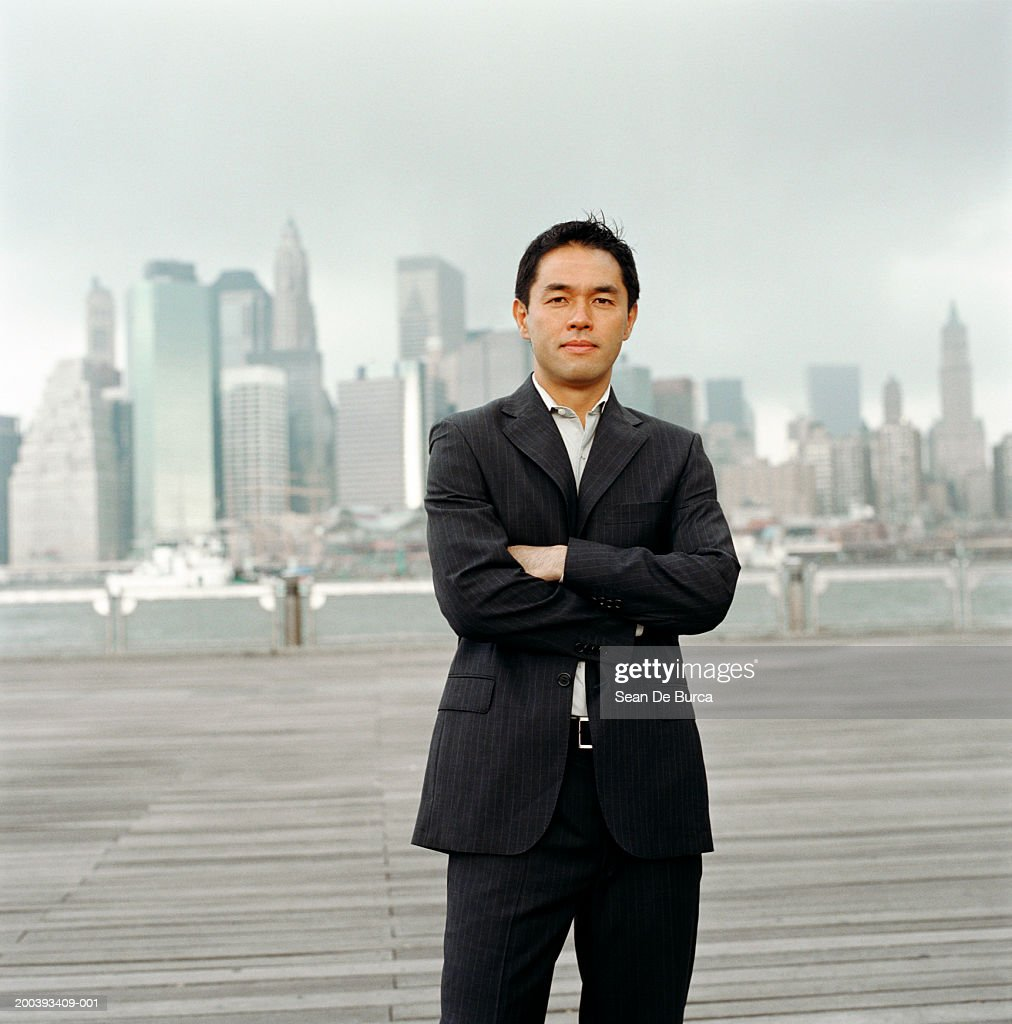 USA, New York City, businessman on riverfront boardwalk, portrait : Stock Photo